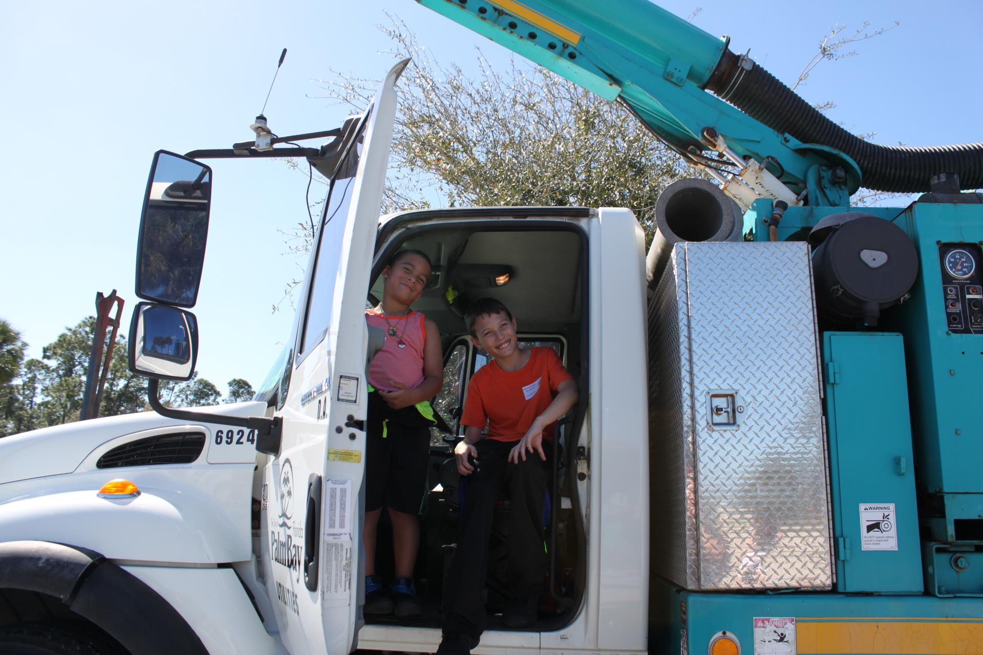 Photo of the Vac-Con truck with Children exploring inside