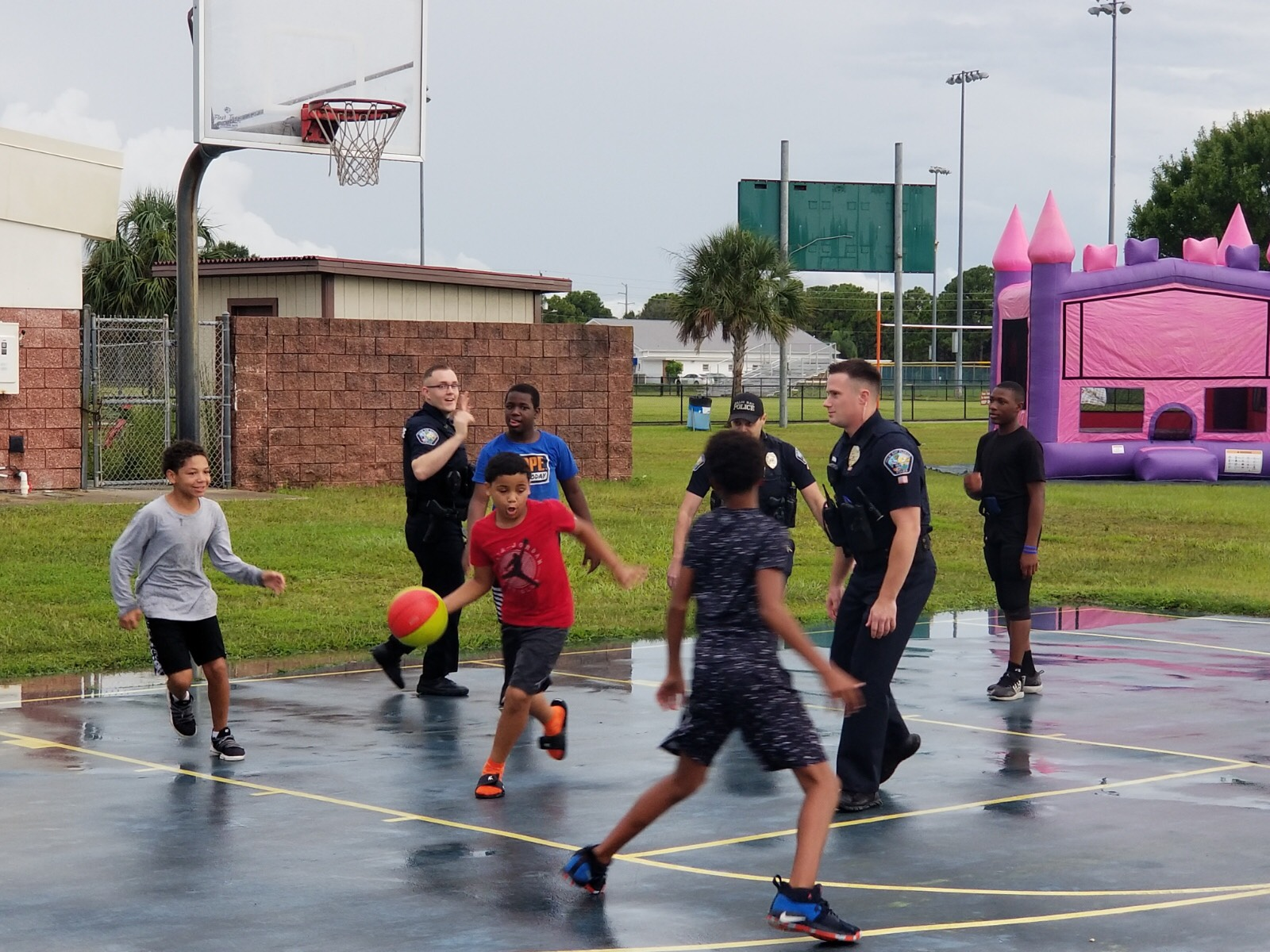 Kids and Officers playing basketball at National Night Out 2019